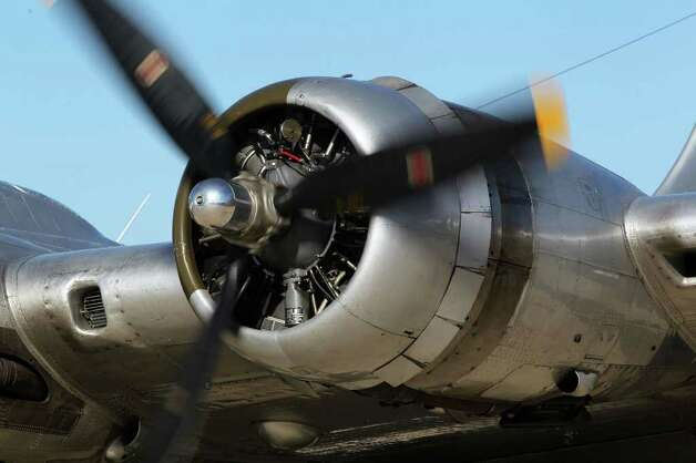 "The B-17 bomber ""Aluminum Overcast"" is powered by four Curtiss Wright nine cylinder radial engines with 1,200 horsepower each. The plane was in Kerrville Wednesday November 16, 2011 and will travel to Houston next. JOHN DAVENPORT/jdavenport@express-news.net Photo: SAN ANTONIO EXPRESS-NEWS"