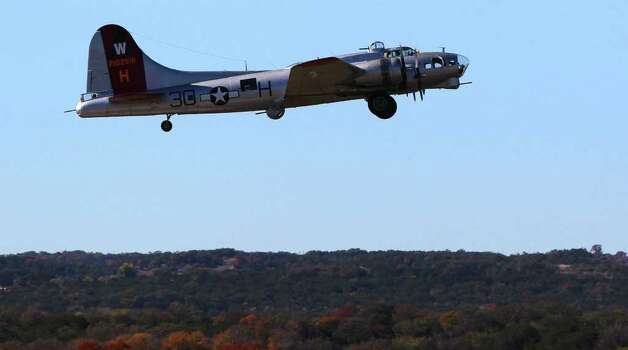 "The B-17 bomber ""Aluminum Overcast"" takes off from Louis Schreiner Field in Kerrville, Texas Wednesday November 16, 2011. The bomber carries the colors of the 398th Bomb Group of World War II. JOHN DAVENPORT/jdavenport@express-news.net Photo: SAN ANTONIO EXPRESS-NEWS"