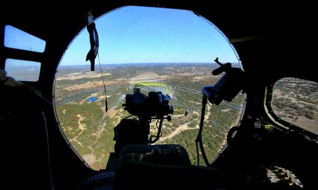 "This is a view from the bombadier's seat as the B-17 ""Aluminum Overcast"" flies over the Texas Hill Country Wednesday November 16, 2011. JOHN DAVENPORT/jdavenport@express-news.net Photo: SAN ANTONIO EXPRESS-NEWS"