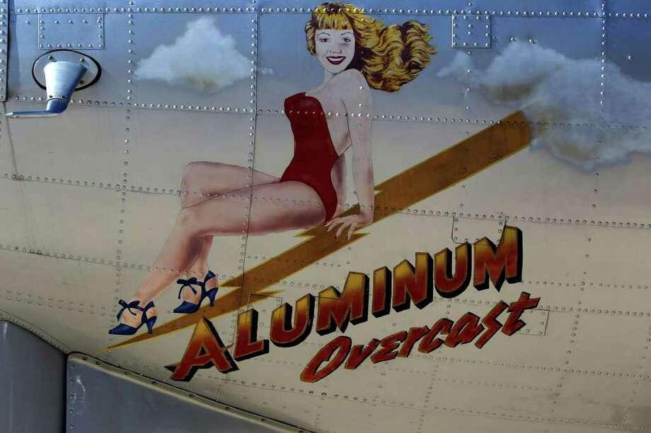 "An artist's rendering is on the nose end below the cockpit windows on the ""Aluminum Overcast"" B-17 bomber. The plane was in Kerrville Wednesday November 16, 2011.  Photo: John Davenport, Jdavenport@express-news.ne"