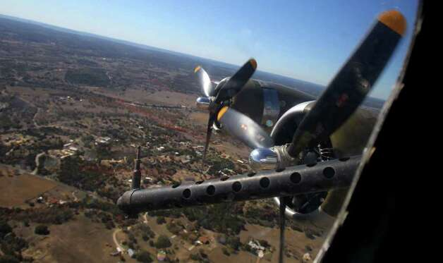 "The WWII era B-17 bomber ""Aluminum Overcast"" flies over the Texas Hill Country Wednesday near Kerrville, Texas. The plane is operated by the Experimental Aircraft Association. JOHN DAVENPORT/jdavenport@express-news.net Photo: SAN ANTONIO EXPRESS-NEWS"