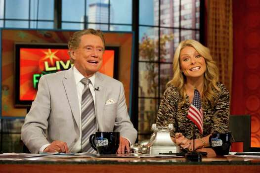 "In this Oct. 28, 2011 photo, long-time talk show host Regis Philbin, talks with co-host Kelly Ripa during a broadcast of ""Live! with Regis and Kelly"", in New York.  After ruling morning television for 28 years as New York's Everyman-about-town, the co-host who made performance art of TV gab is exiting what for a decade has been known as ""Live! With Regis and Kelly."" His last day is Nov. 18. (AP Photo/Charles Sykes) Photo: Charles Sykes, Associated Press / FR170266 AP"