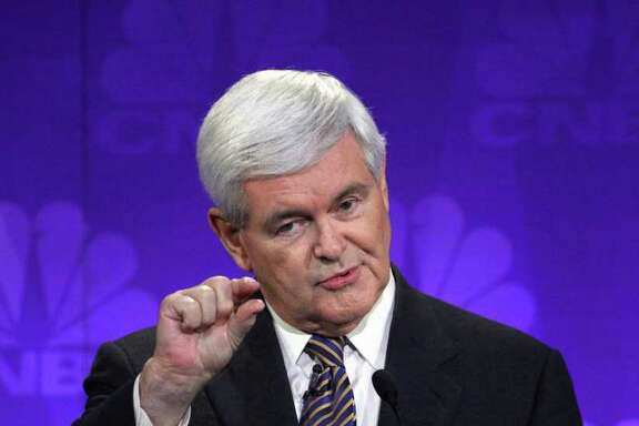 FILE - In this Nov. 9, 2011 file photo, Republican presidential candidate former House Speaker Newt Gingrich speaks during a Republican Presidential Debate at Oakland University in Auburn Hills, Mich.  Rising in national polls, Gingrich found himself on the defensive Wednesday over huge payments he received over the past decade from the housing mortgage giant Freddie Mac. (AP Photo/Paul Sancya, File)