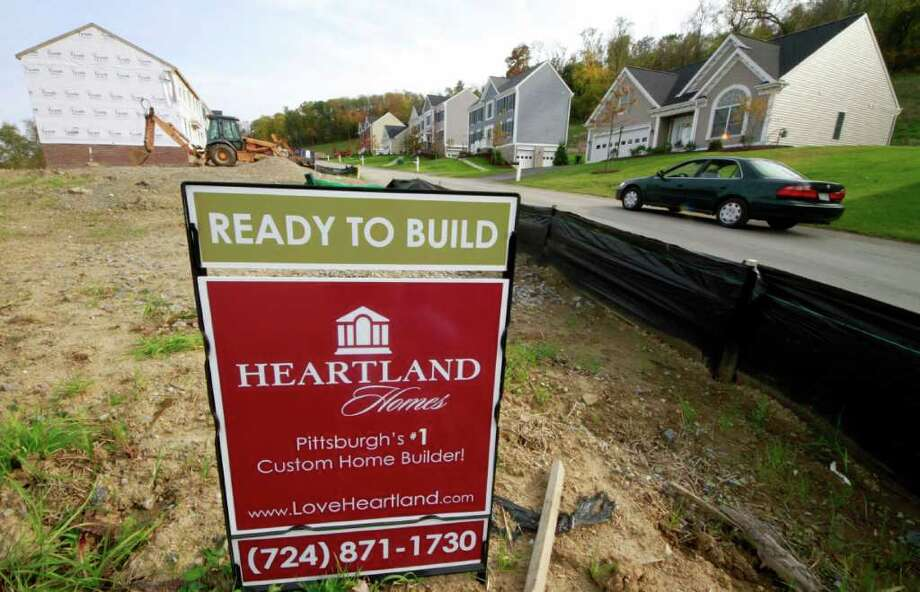 This Oct. 18, 2011 shows a new homesite in a development in Canonsburg, Pa. U.S. homebuilders are feeling a little less pessimistic about the struggling housing market. But their mood hasn't changed enough to signal a recovery anytime soon. (AP Photo/Gene J. Puskar) Photo: Gene J. Puskar