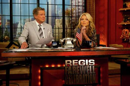 "Regis Philbin and Kelly Ripa appear on set during the taping of ""Live! with Regis and Kelly"", in New York, Friday, Oct. 28, 2011. (AP Photo/Charles Sykes) Photo: Charles Sykes / FR170266 AP"