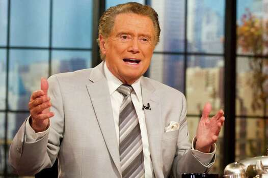 "In this Oct. 28, 2011 photo, long-time talk show host Regis Philbin gestures during a broadcast of ""Live! with Regis and Kelly"", in New York.  After ruling morning television for 28 years as New York's Everyman-about-town, the co-host who made performance art of TV gab is exiting what for a decade has been known as ""Live! With Regis and Kelly."" His last day is Nov. 18. (AP Photo/Charles Sykes) Photo: Charles Sykes / FR170266 AP"