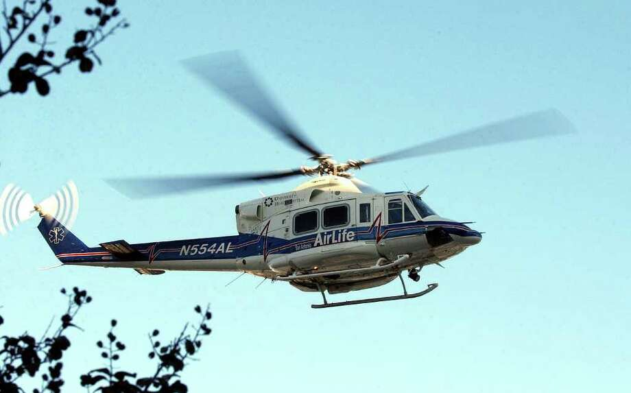 A grant will allow San Antonio AirLife to fly its helicopter ambulances to surrounding counties in fog and low clouds. Photo: KIN MAN HUI, SAN ANTONIO EXPRESS-NEWS / SAN ANTONIO EXPRESS-NEWS