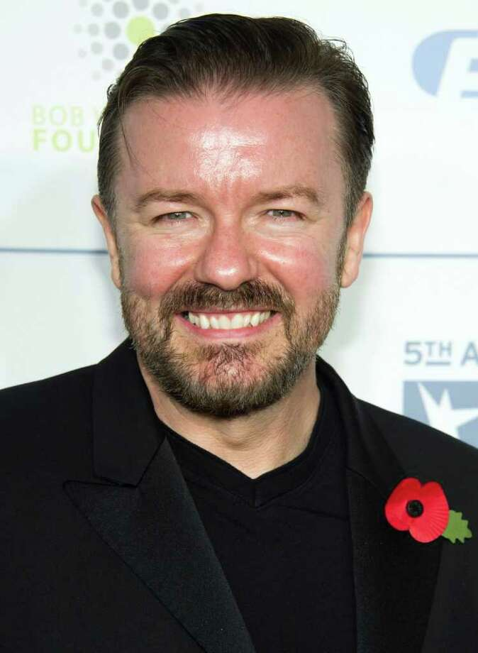 FILE - In this Nov. 9, 2011 file photo, Ricky Gervais attends the New York Comedy Festival's Stand Up For Heroes benefit in New York. The Hollywood Foreign Press Association announced through Twitter Wednesday, Nov. 16, that Gervais will host the ceremony in January. The 69th annual Golden Globe Awards will be held Jan. 15, 2012. (AP Photo/Charles Sykes, file) Photo: Charles Sykes