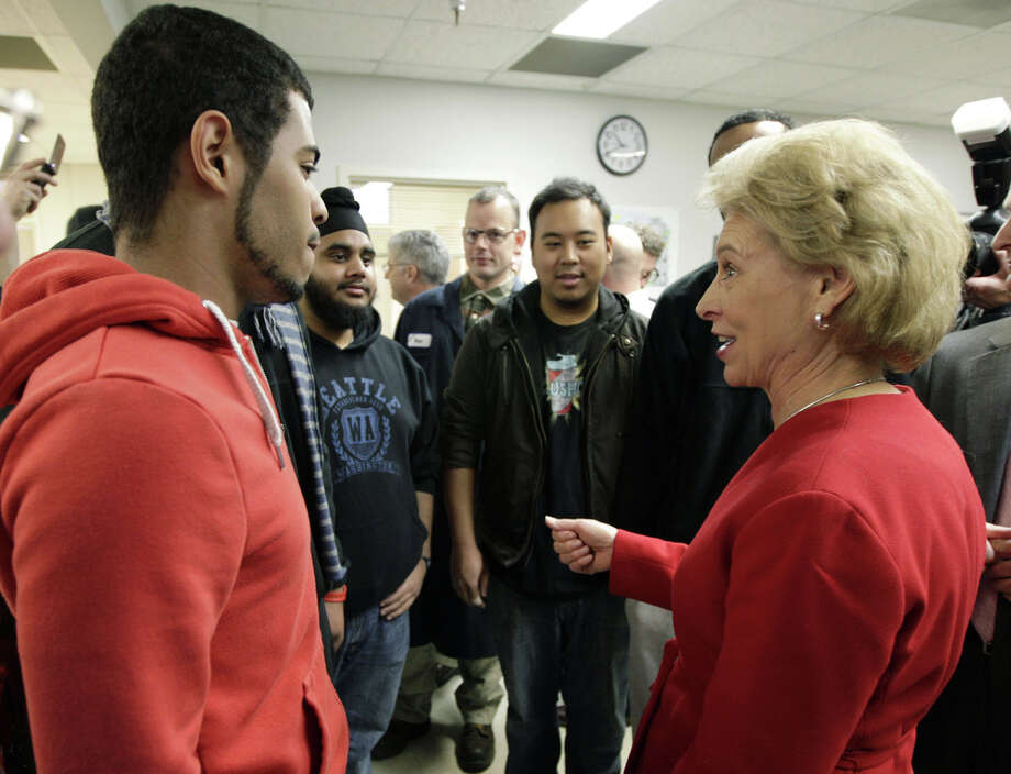 Washington Gov. Chris Gregoire, right, speaks Wednesday, Nov. 16, 2011, to students at Renton Technical College in Renton, Wash. Photo: Ted S. Warren, AP Photo