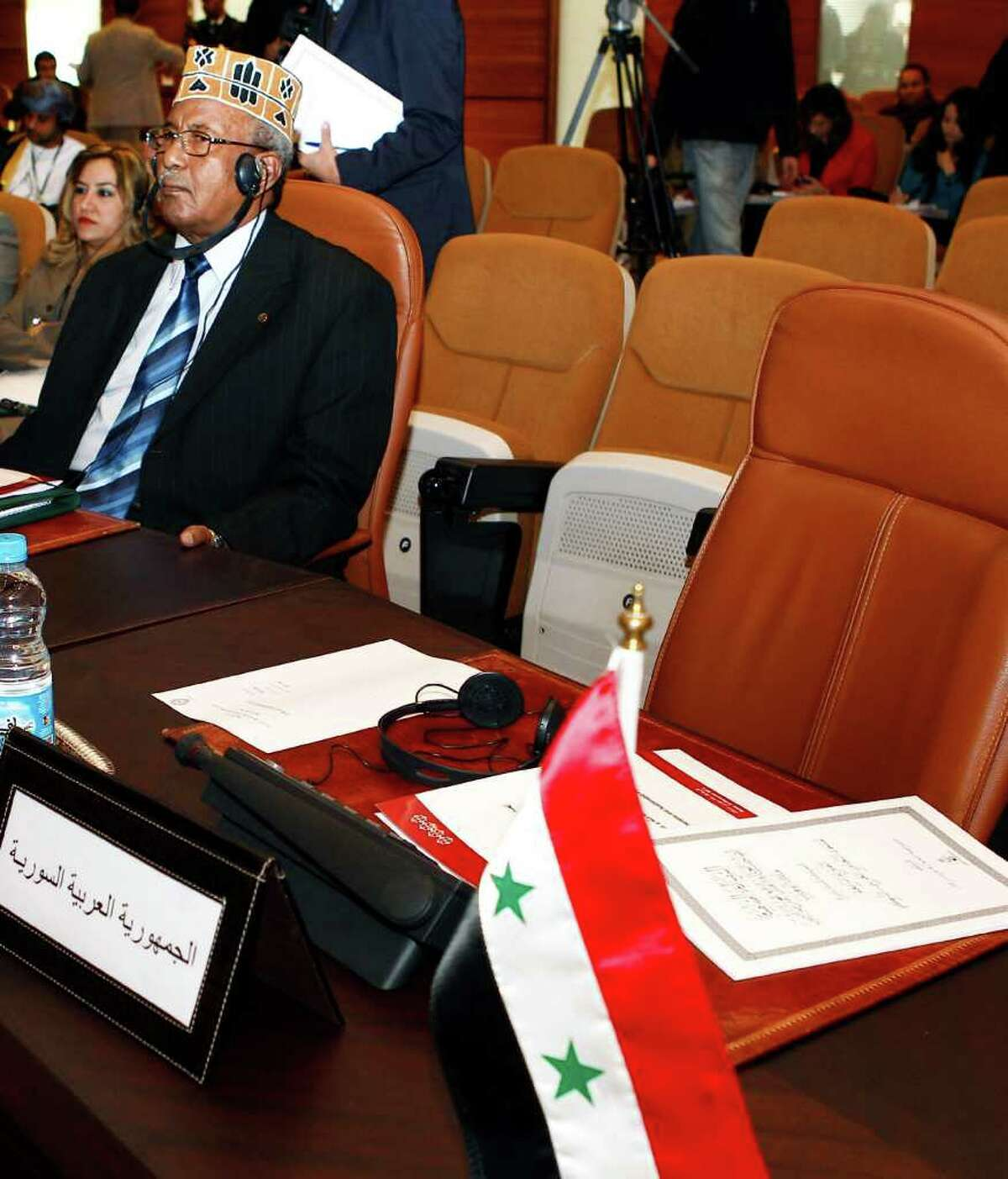 The empty chair of the Syrian delegate is seen at Arab League foreign ministers meeting in Rabat, Morocco, on Wednesday.