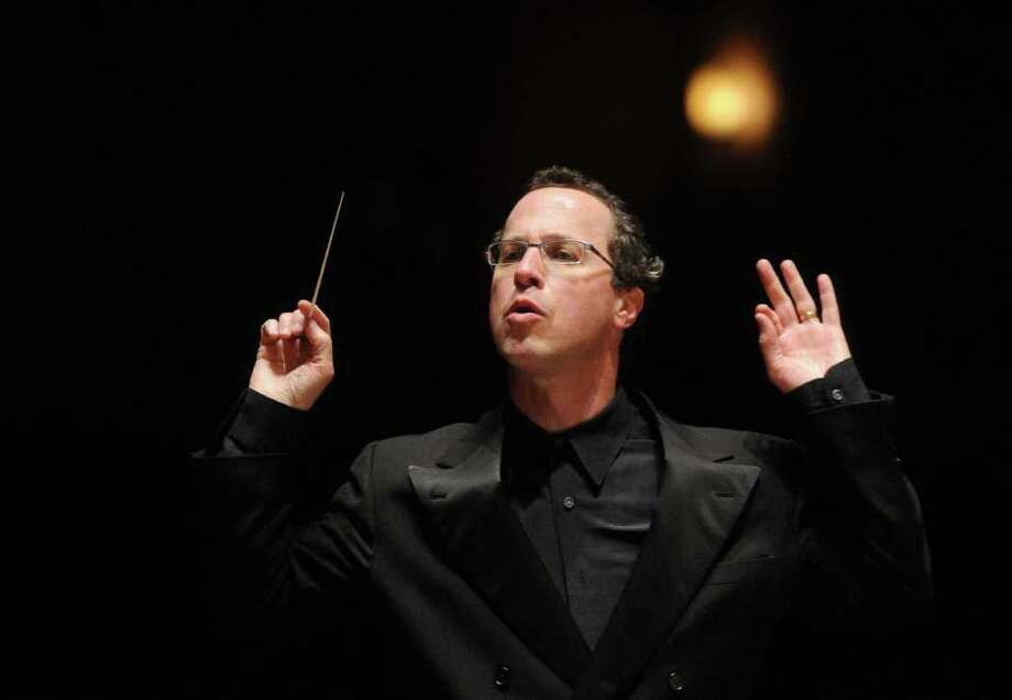 Albany Symphony Orchestra Conductor David Alan Miller during rehearsal at the Palace Theater in Albany on Friday, April 17, 2009. (Patrick Dodson / Times Union) Photo: PATRICK DODSON / 00003425A