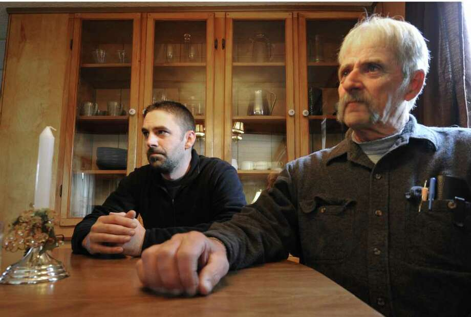 Eugene Clark IV and his father, Eugene Clark III, talk about quitting smoking at the older man's home in Malta, N.Y. Nov. 15, 2011.  (Skip Dickstein/Times Union) Photo: Skip Dickstein / 00015408A