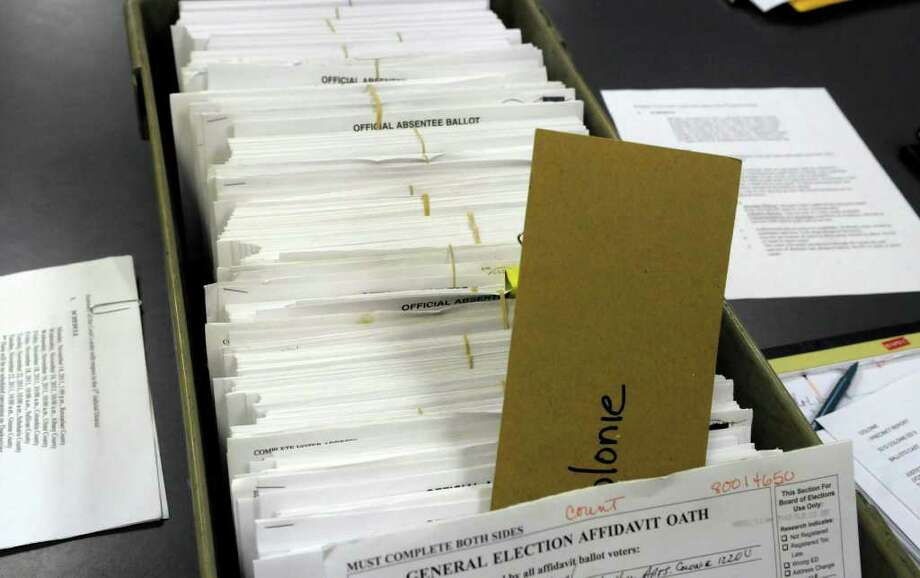 A tray of absentee ballots from residents in the town of Colonie are seen on a table at the Albany County Board of Elections as workers prepared to start counting the ballots on Wednesday, Nov. 16, 2011 in Albany, NY.  (Paul Buckowski / Times Union) Photo: Paul Buckowski / 00015435A
