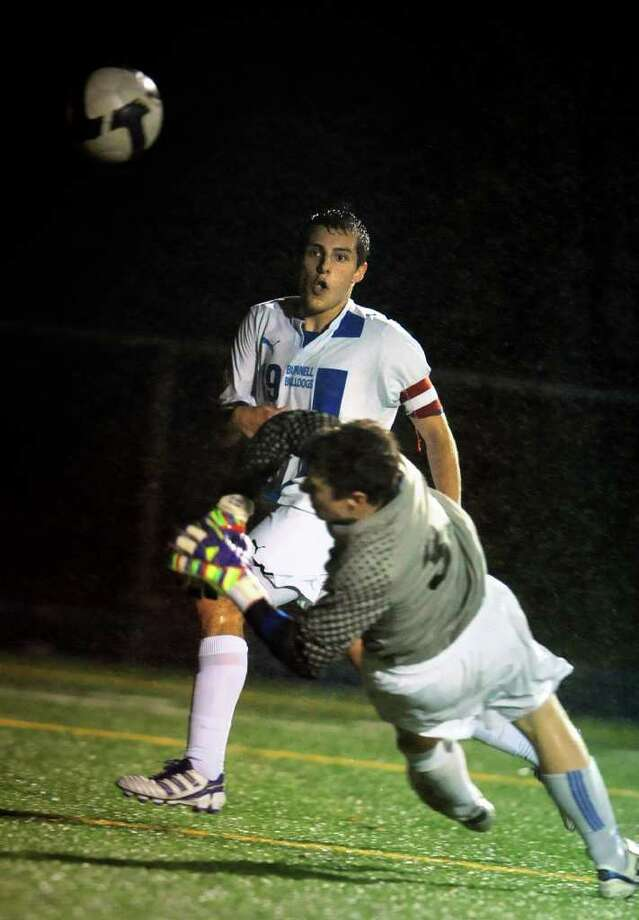 Bunnell's Zachary Zurita gets the ball past Darien keeper Eric Kanigan during the 2011 Class L Boys Soccer quarterfinal match Wednesday, Nov. 16, 2011 at Bunnell High School in Stratford, Conn. Photo: Autumn Driscoll / Connecticut Post