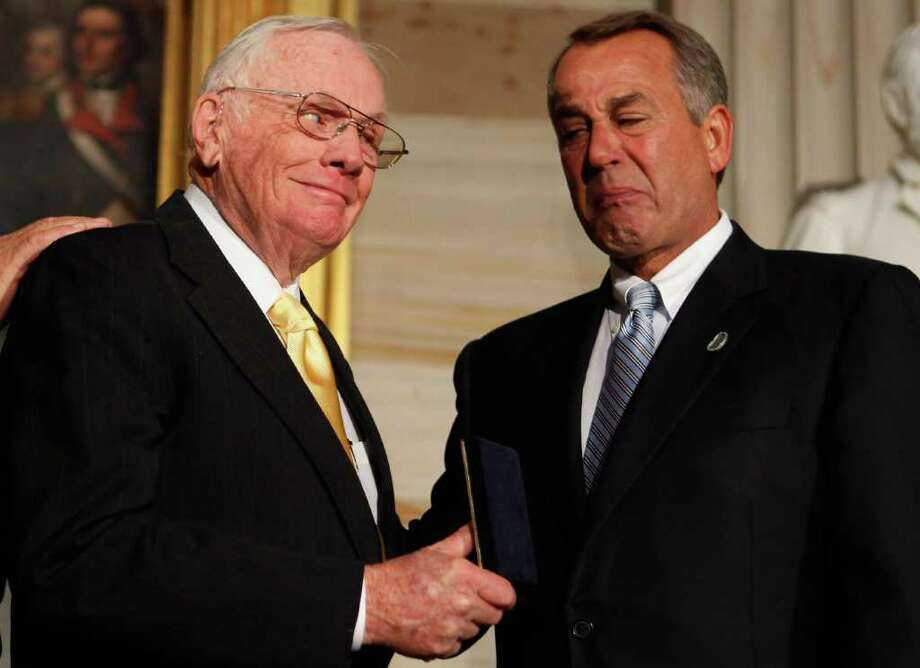 Astronaut Neil Armstrong (L) receives the Congressional Gold Medal from Speaker of the House John Boehner (R-OH) during a ceremony in the Rotunda of the U.S. Capitol November 16, 2011 in Washington, DC. The gold medals were presented to Armstrong and his fellow crew members from Apollo 11, Michael Collins and Buzz Aldrin, and to astronaut and former U.S. Senator John Glenn (D-OH), the first American to orbit the Earth. Photo: Chip Somodevilla, Getty / 2011 Getty Images