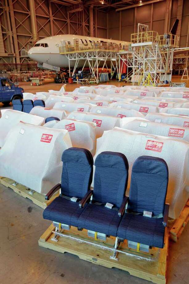 This Oct. 28, 2011 photo, shows new seats for a United Airlines, Boeing 777 plane that is being retrofitted at San Francisco International Airport in San Francisco. U.S. factory output increased in October by the most in three months on strong demand for business equipment, electronics and autos. (AP Photo/Tony Avelar) Photo: Tony Avelar