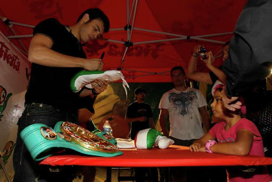 Boxer Julio Cesar Chavez, Jr. signs autographs at the Fiesta, Nov. 16, 2011. Photo: Karen Warren, Houston Chronicle / © 2011 Houston Chronicle