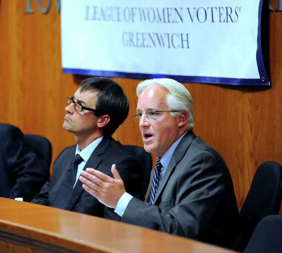 Entergy spokesman James Steets, right, makes a point during a League of Women Voters of Greenwich panel discussion on nuclear safety at Greenwich Town Hall, Wednesday night, Nov. 16, 2011. At left is Phillip Musegaas of Riverkeeper, an organization dedicated to defending the environmental health of the Hudson River.  Steets represents the owner of Indian Point nuclear power plant in Buchanan, N.Y., which is 20 miles from Greenwich. Photo: Bob Luckey / Greenwich Time