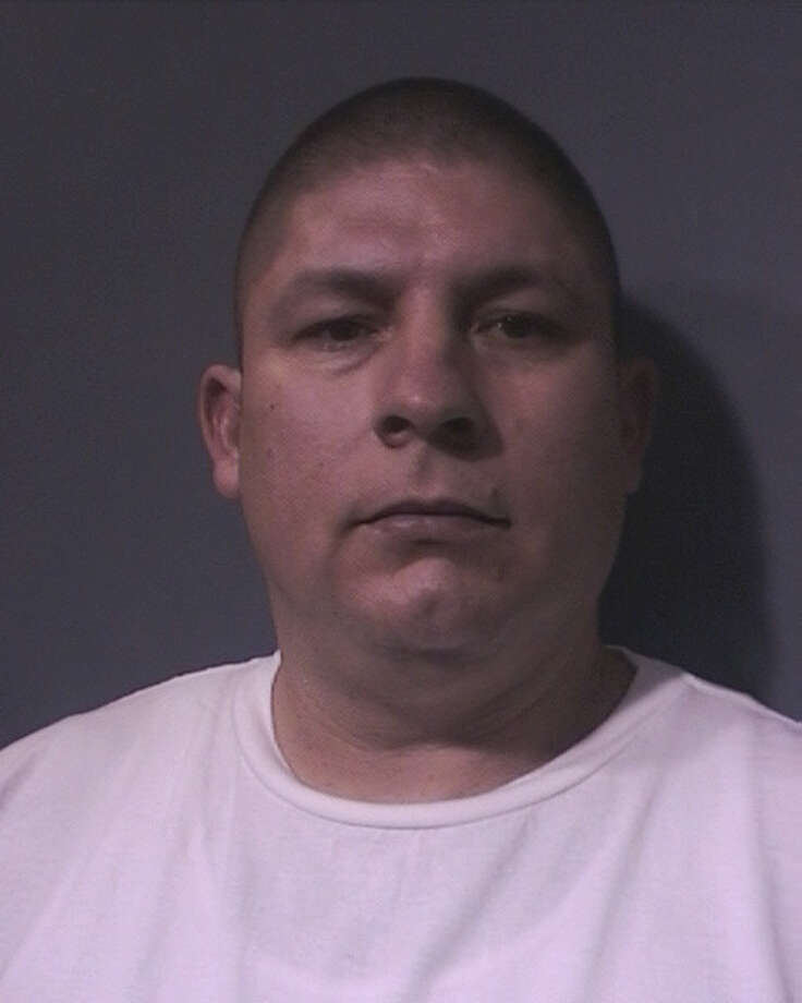 Jesus Serna, 41, was charged, along with his brother, this week with capital murder in a 13-year-old shooting at a north Harris County apartment that left two men dead, authorities said. Jesus Serna is charged in the death of Ali Lamonte Scott,19, who was fatally shot April 20, 1998, authorities said. / Harris County Sheriff's Office