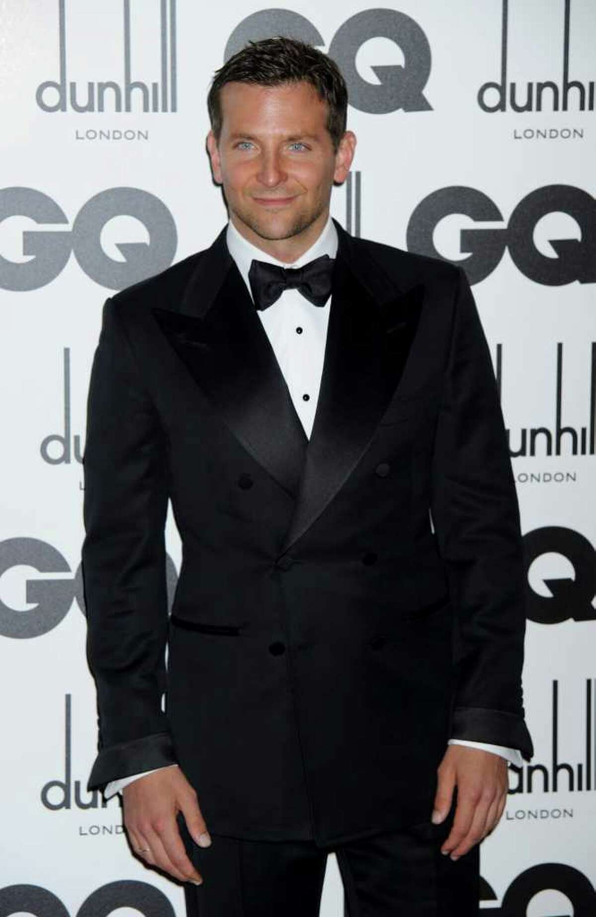 """FILE - In this Sept. 6, 2011 file photo, actor Bradley Cooper arrives for the GQ Men of the Year Awards in London. Cooper was named """"People"""" magazine's sexiest man alive. (AP Photo/Jonathan Short, file)"""