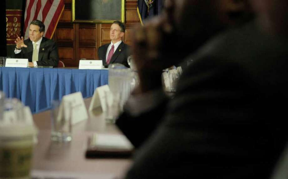 Governor Andrew Cuomo, left, addresses members of his cabinet  as Lieutenant Governor Robert Duffy looks on during a meeting at the capitol on Wednesday, Nov. 16, 2011 in Albany, NY.  (Paul Buckowski / Times Union) Photo: Paul Buckowski / 00015438A