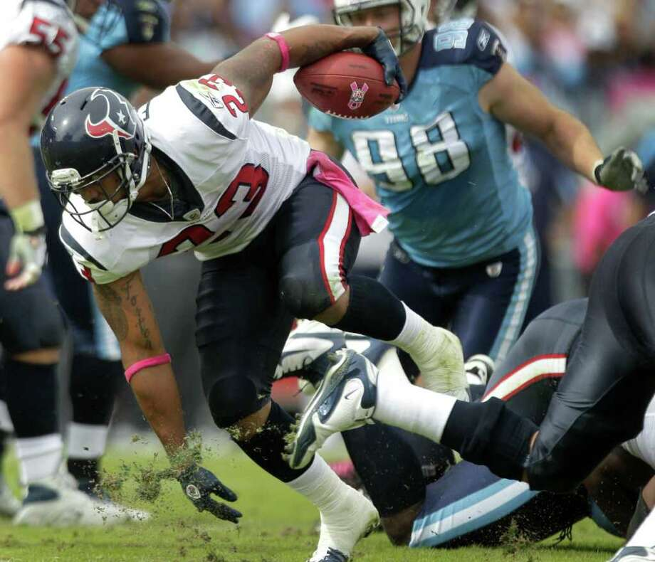 Texans running back Arian Foster (23) runs through the Tennessee Titans defense during the first quarter of an NFL football game at LP Field Sunday, Oct. 23, 2011, in Nashville. The Texans beat the Titans 41-7. ( Photo: Brett Coomer / © 2011  Houston Chronicle