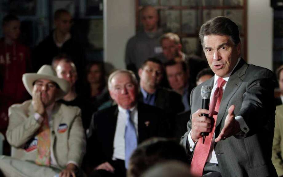 Republican presidential candidate, Texas Gov. Rick Perry speaks during a campaign stop at a VFW post, Wednesday, Nov. 16, 2011, in Nashua, N.H. (AP Photo/Jim Cole) Photo: Jim Cole