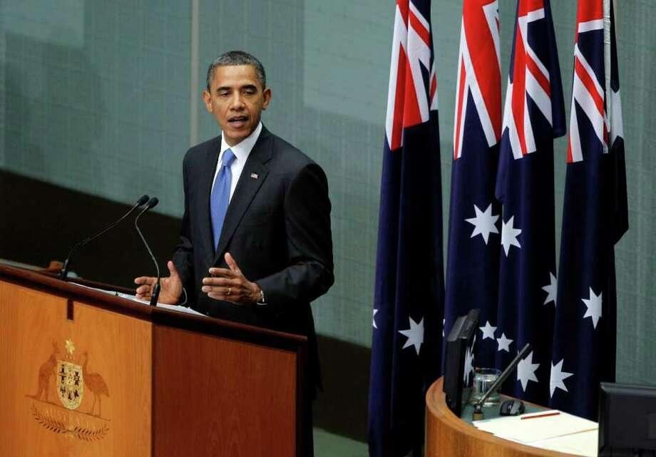 U.S. President Barack Obama addresses the Australian Parliament in Canberra, Australia, Thursday, Nov. 17, 2011. (AP Photo/Jason Reed, Pool) Photo: Jason Reed
