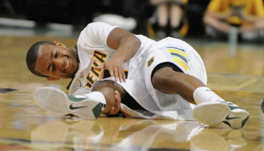 Siena's Evan Hymes gets a bad cramp toward the end of a basketball game against Navy at the Times Union Center in Albany, N.Y. Wednesday, Nov. 16, 2011.  (Lori Van Buren / Times Union) Photo: Lori Van Buren