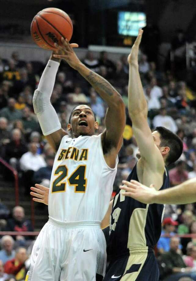 Siena's Davonte Beard drives to the basket during a basketball game against Navy at the Times Union Center in Albany, N.Y. Wednesday, Nov. 16, 2011.  (Lori Van Buren / Times Union) Photo: Lori Van Buren