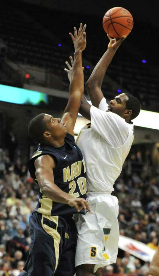 Navy's Carlton Smith tries to block Brandon Walters as he drives to the basket during a basketball game at the Times Union Center in Albany, N.Y. Wednesday, Nov. 16, 2011.  (Lori Van Buren / Times Union) Photo: Lori Van Buren