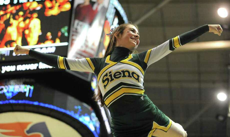 A Siena cheerleader is held up high during the first basketball game of the season against Navy at the Times Union Center in Albany, N.Y. Wednesday, Nov. 16, 2011.  (Lori Van Buren / Times Union) Photo: Lori Van Buren