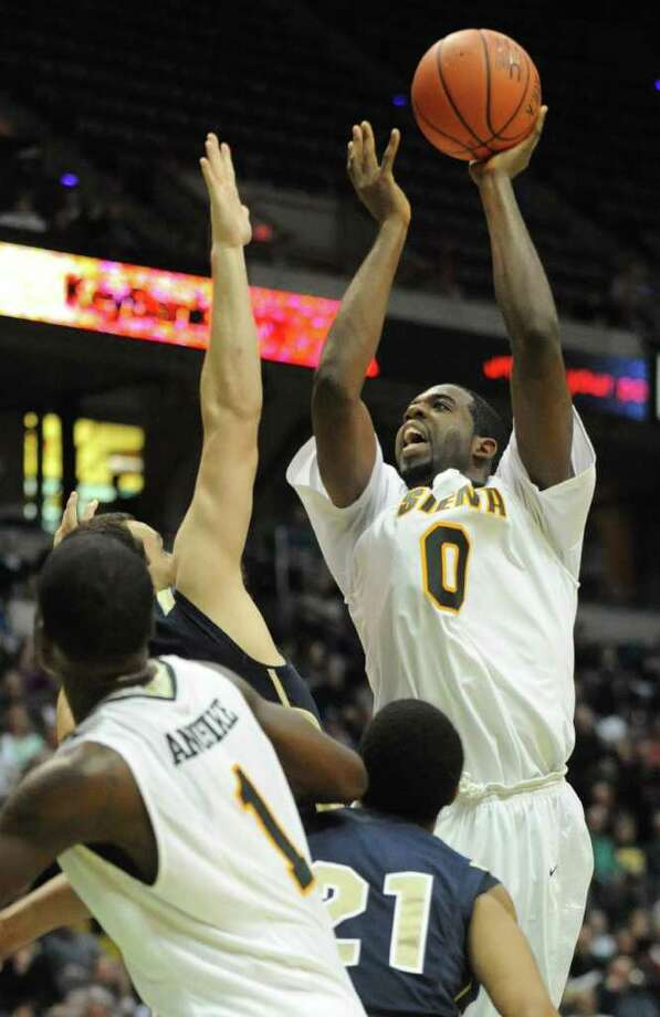 Brandon Walters drives to the basket during a basketball game against Navy at the Times Union Center in Albany, N.Y. Wednesday, Nov. 16, 2011.  (Lori Van Buren / Times Union) Photo: Lori Van Buren