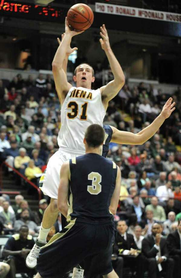 Siena's Owen Wignot gets hurt on this drive to the basket during a basketball game against Navy at the Times Union Center in Albany, N.Y. Wednesday, Nov. 16, 2011.  (Lori Van Buren / Times Union) Photo: Lori Van Buren