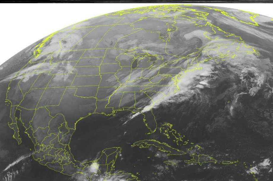 This NOAA satellite image taken Thursday, Nov. 17, 2011 at 12:45 a.m. EST shows dense cloud cover along the East Coast as a cold front moves across the area with light to moderate rain showers. Additional cloud cover remains over the Ohio and Tennessee Valleys. (AP PHOTO/WEATHER UNDERGROUND) / WEATHER UNDERGROUND
