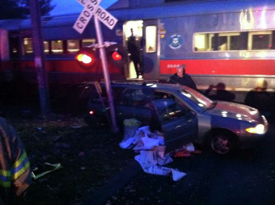 A car driven by an Advocate newspaper carrier was hit by a New Canaan-bound train early on the morning of Thursday, Nov. 17, 2011, halting service on the New Canaan Branch. The carrier was not seriously injured. Photo: John Nickerson