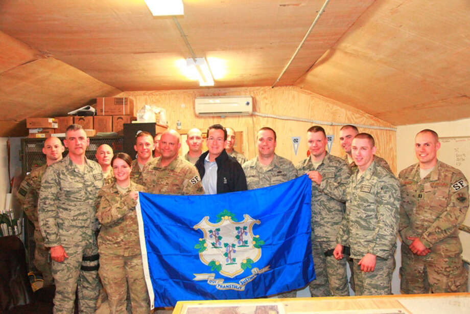 Connecticut Governor Dannel P. Malloy poses to take a photo with soldiers from East Granby, Connecticut of the 103rd Security Forces Squadron (CT ANG) stationed at Bagram Airfield during his visit to Afghanistan on November 16, 2011. (U.S. Army photo by Spc. Anthony Murray Jr/Released) Photo: Contributed Photo