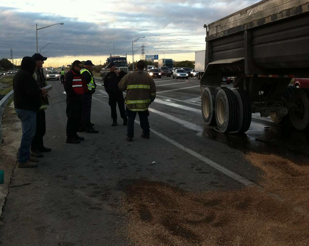 Emergency crews were at the scene through the early morning trying to clear debris and fuel spilled by the freightliner.