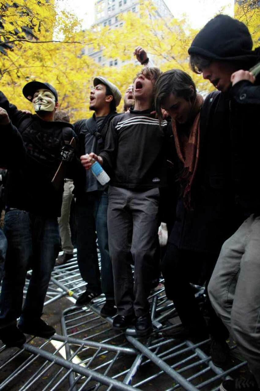 Occupy Wall Street protesters dance on police barricades in Zuccotti Park on November 17, 2011 in New York City. Hundreds of protesters attempted to shut down the New York Stock Exchange today, blocking roads and tying up traffic in Lower Manhattan.