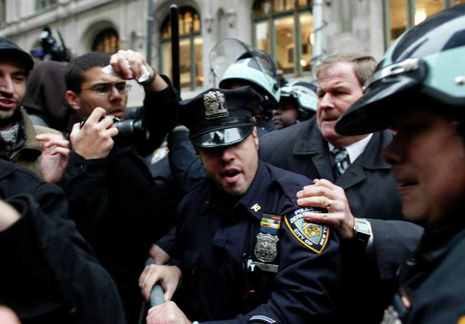 Occupy Wall Street protesters clash with police in Zuccotti Park on November 17, 2011 in New York City. Hundreds of protesters attempted to shut down the New York Stock Exchange today, blocking roads and tying up traffic in Lower Manhattan. Photo: Allison Joyce, Getty / 2011 Getty Images