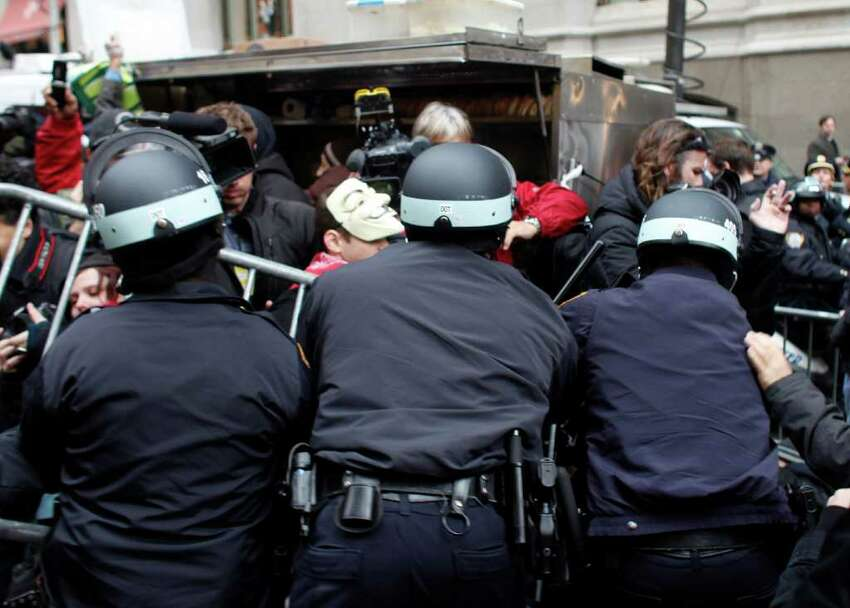 Occupy Wall Street protesters clash with police on November 17, 2011 in New York City. Hundreds of protesters attempted to shut down the New York Stock Exchange today, blocking roads and tying up traffic in Lower Manhattan.