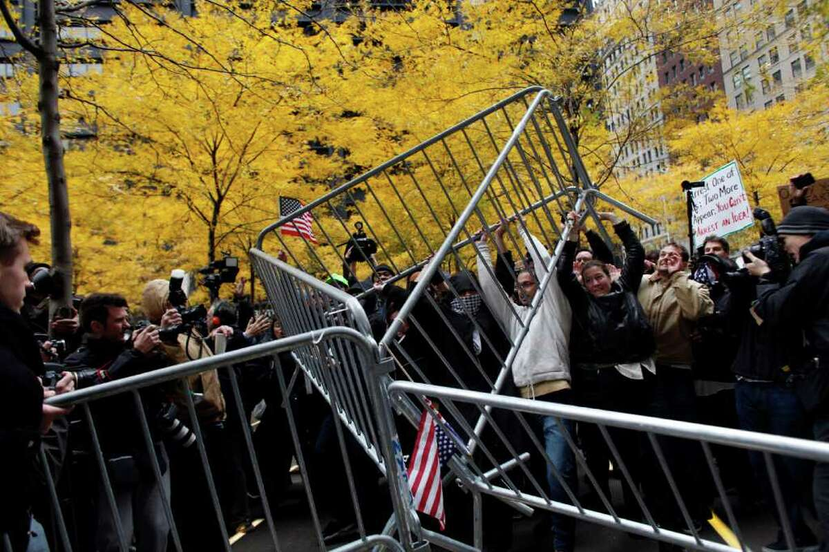 NEW YORK, NY - NOVEMBER 17: Occupy Wall Street protesters remove police barricades in Zuccotti Park on November 17, 2011 in New York City. Hundreds of protesters attempted to shut down the New York Stock Exchange today, blocking roads and tying up traffic in Lower Manhattan. (Photo by Allison Joyce/Getty Images)