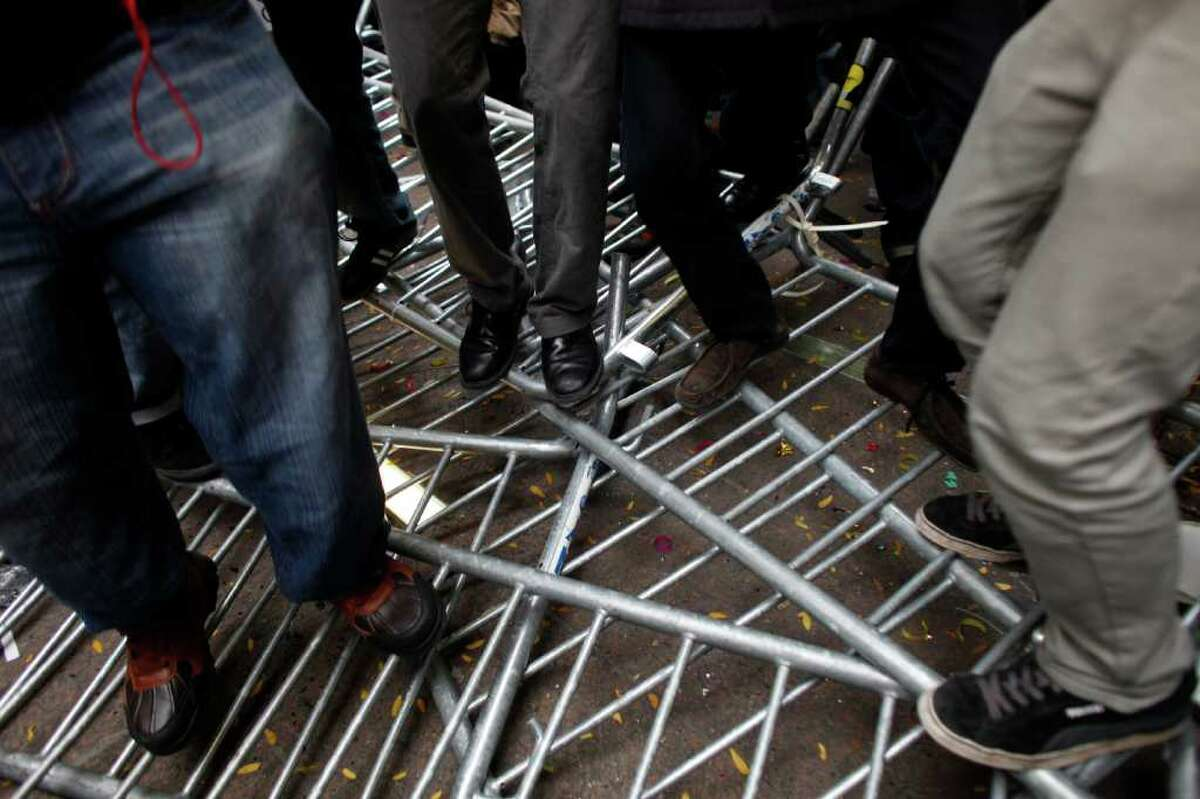 NEW YORK, NY - NOVEMBER 17: Occupy Wall Street protesters dace on police barricades in Zuccotti Park on November 17, 2011 in New York City. Hundreds of protesters attempted to shut down the New York Stock Exchange today, blocking roads and tying up traffic in Lower Manhattan. (Photo by Allison Joyce/Getty Images)