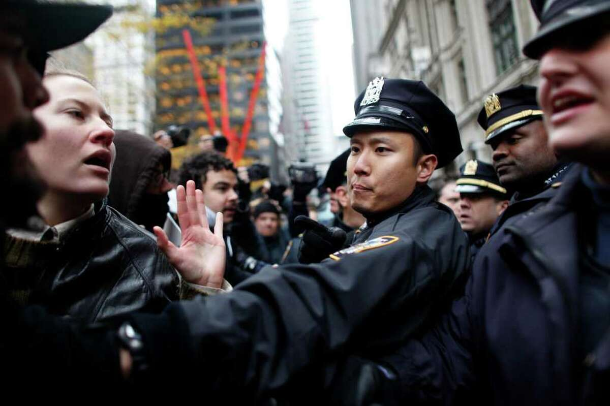 NEW YORK, NY - NOVEMBER 17: Occupy Wall Street protesters clash with police in Zuccotti Park on November 17, 2011 in New York City. Hundreds of protesters attempted to shut down the New York Stock Exchange today, blocking roads and tying up traffic in Lower Manhattan. (Photo by Allison Joyce/Getty Images)