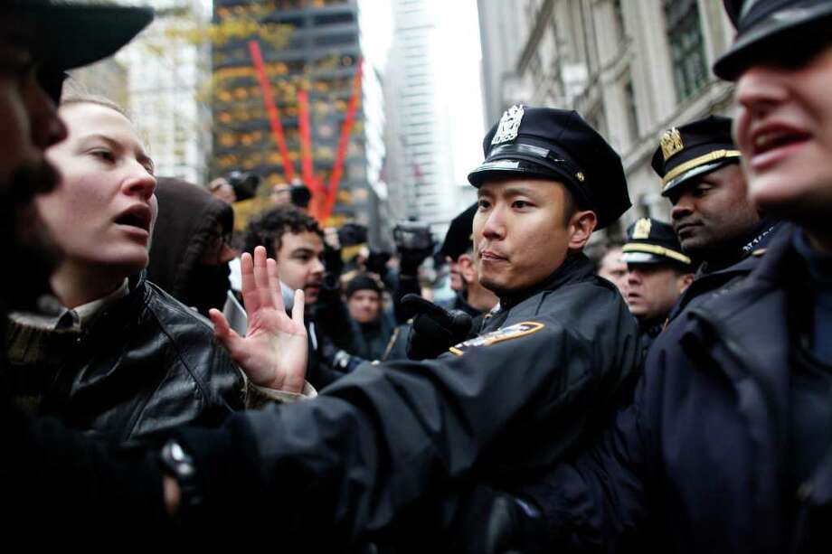NEW YORK, NY -  NOVEMBER 17:  Occupy Wall Street protesters clash with police in Zuccotti Park on November 17, 2011 in New York City. Hundreds of protesters attempted to shut down the New York Stock Exchange today, blocking roads and tying up traffic in Lower Manhattan. (Photo by Allison Joyce/Getty Images) Photo: Allison Joyce, Getty / 2011 Getty Images