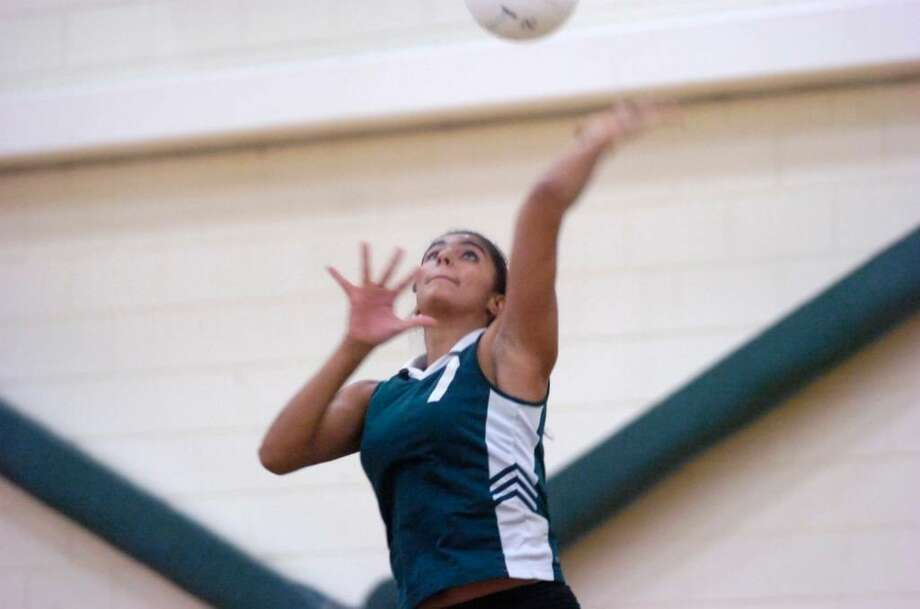 Greenwich Academy's Niliezer Vazquez throttles an ace as Greenwich Academy hosts Hamden Hall for a volleyball game Wednesday afternoon, Oct. 21, 2009. Photo: Keelin Daly / Greenwich Time