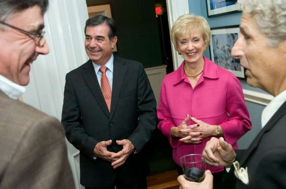 "Republican mayoral candidate Michael Pavia, left, and Republican senatorial candidate Linda McMahon, right, talks to guests during a Pavia campaign fundraiser billed as ""Mikestock"" at the Hotel Chesterfield in the Shippan section ofStamford on Tuesday, Oct. 20, 2009. Republican senatorial candidate Linda McMahon, of Stamford, appeared at events with Pavia on Tuesday. Photo: Chris Preovolos / Stamford Advocate"
