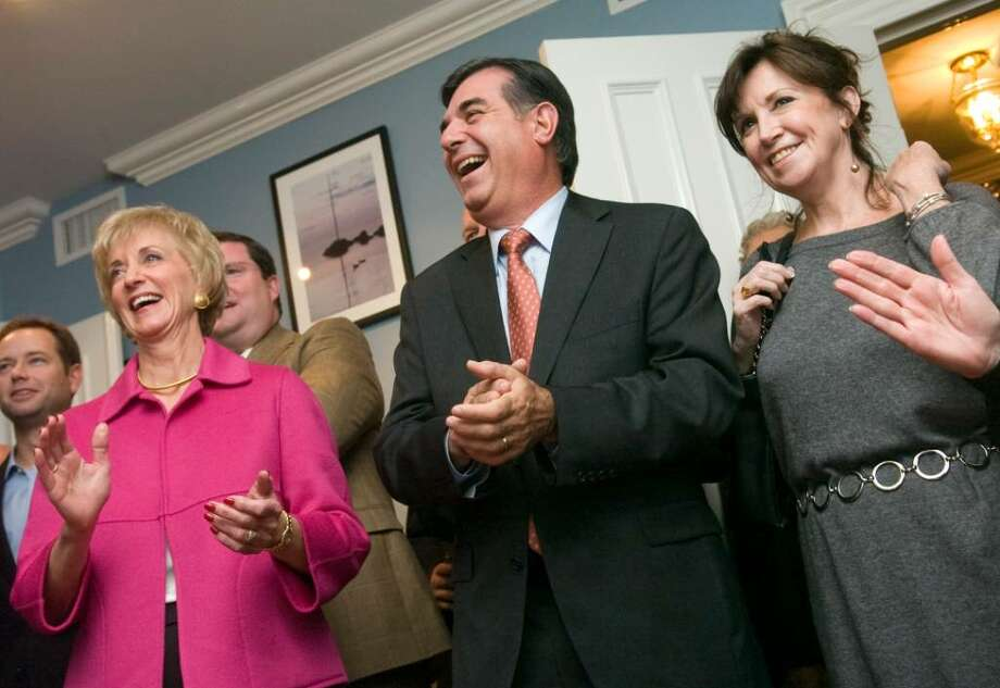 "From left, Linda McMahon, Michael Pavia and his wife Maureen Pavia,  listen to Felix Cavaliere, a founding member of The Rascals performs during a Pavia campaign fundraiser billed as ""Mikestock"" at the Hotel Chesterfield in the Shippan section of Stamford on Tuesday, Oct. 20, 2009. Republican senatorial candidate Linda McMahon, of Stamford, appeared at events with Pavia on Tuesday. Photo: Chris Preovolos / Stamford Advocate"