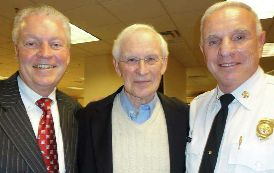 Robert H. Gillette, center, a former Fairfield resident and teacher, with First Selectman Mike Tetreau, left, who had been one of his students, and Fire Chief Richard Felner on Wednesday when Gillette discussed his new book about an unsung Holocaust hero in a presentation at the Fairfield University Bookstore. Photo: Meg Barone / Fairfield Citizen freelance