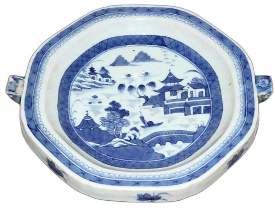 This unusual Chinese export dish was made in the 18th century to keep food warm. The dishís Fitzhugh pattern was used for full sets of dishes. The warming dish is 10 inches in diameter and sold for $211 at a 2011 DuMouchelles auction in Detroit. Photo: Contributed Photo
